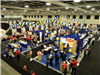 Aerial view of convention center trade show decorated in yellow and blue colors
