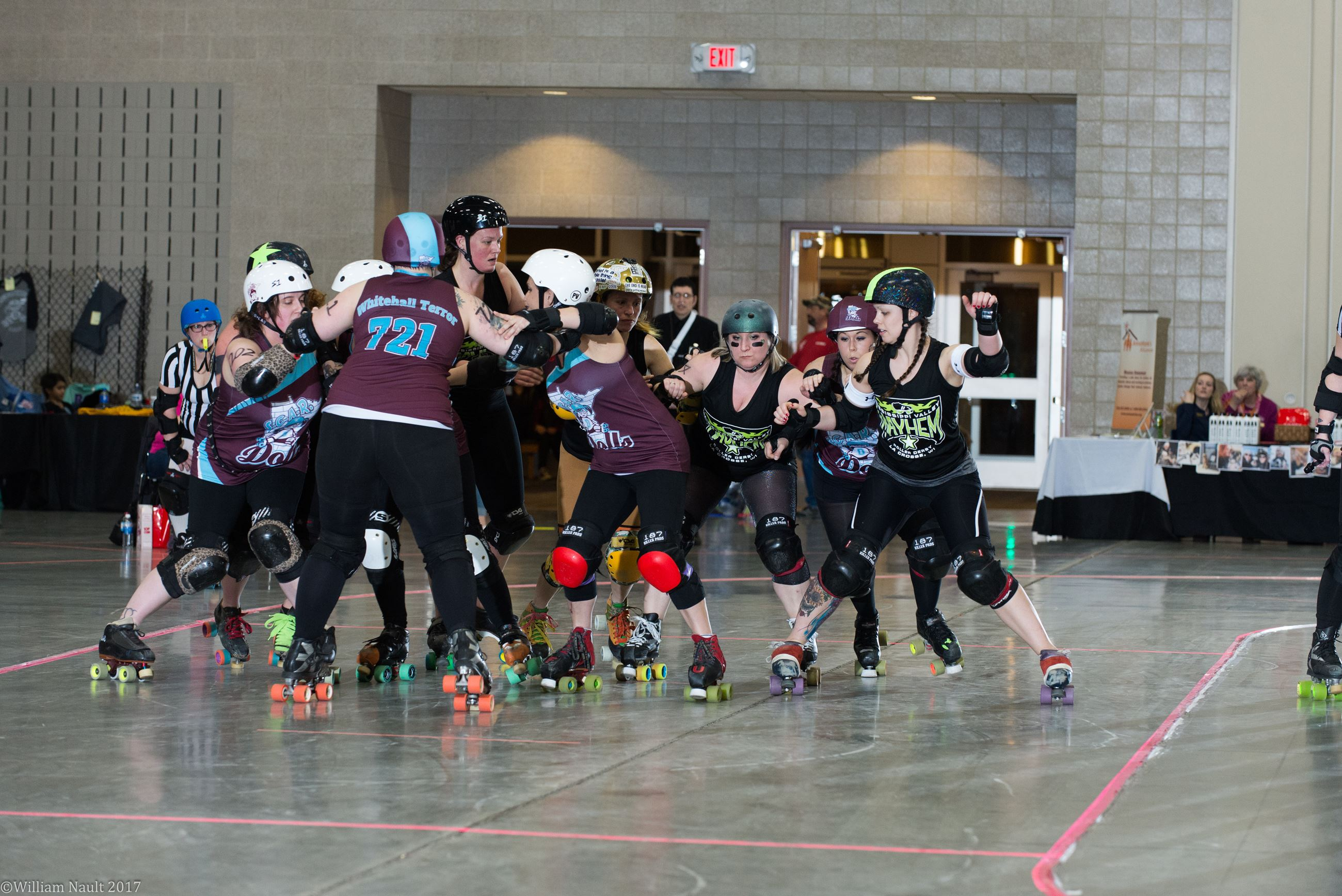 Two teams of women competing in roller derby