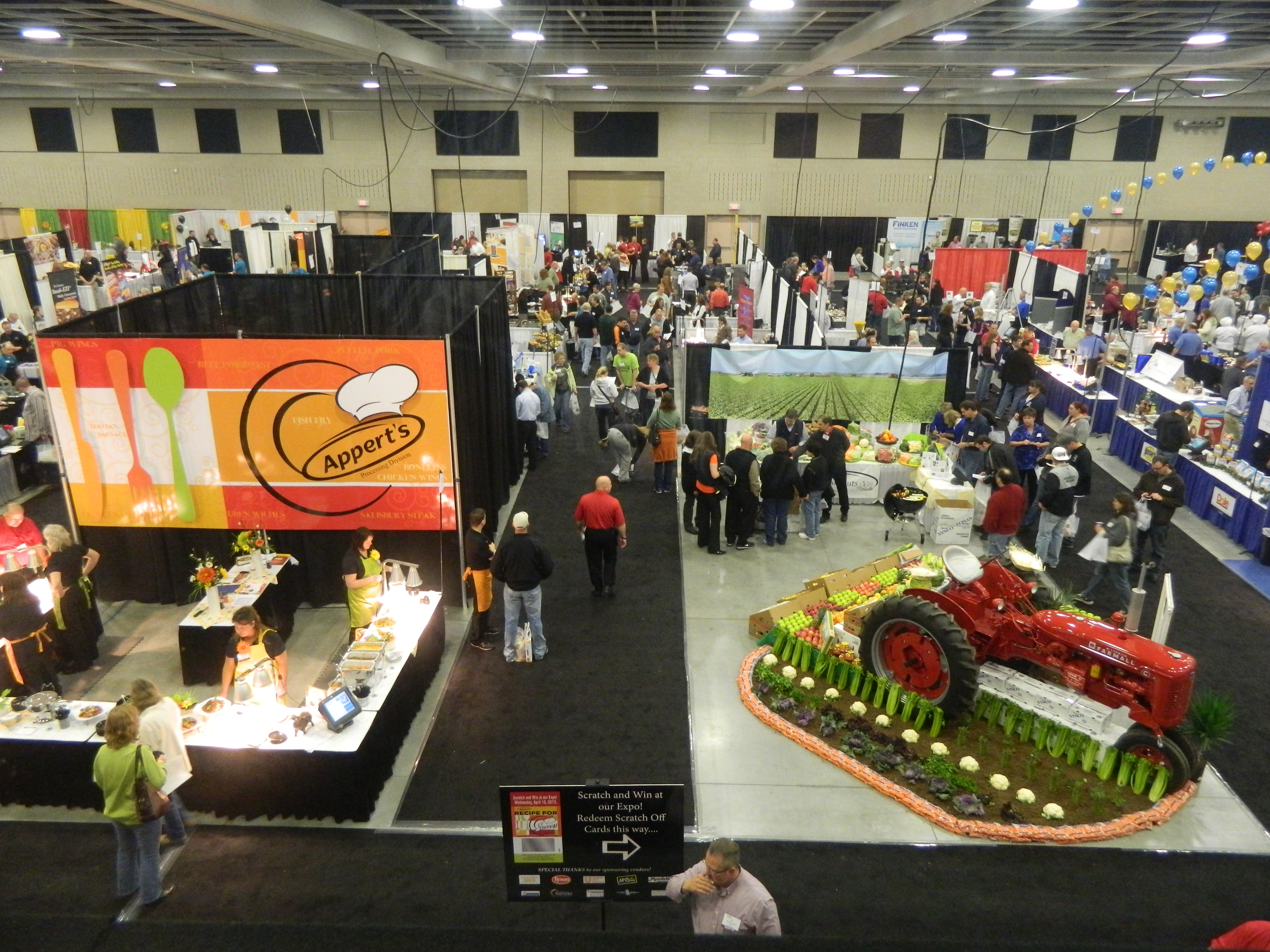 Aerial view of people and a variety of exhibits in convention hall for Appert's Food Service Food Show