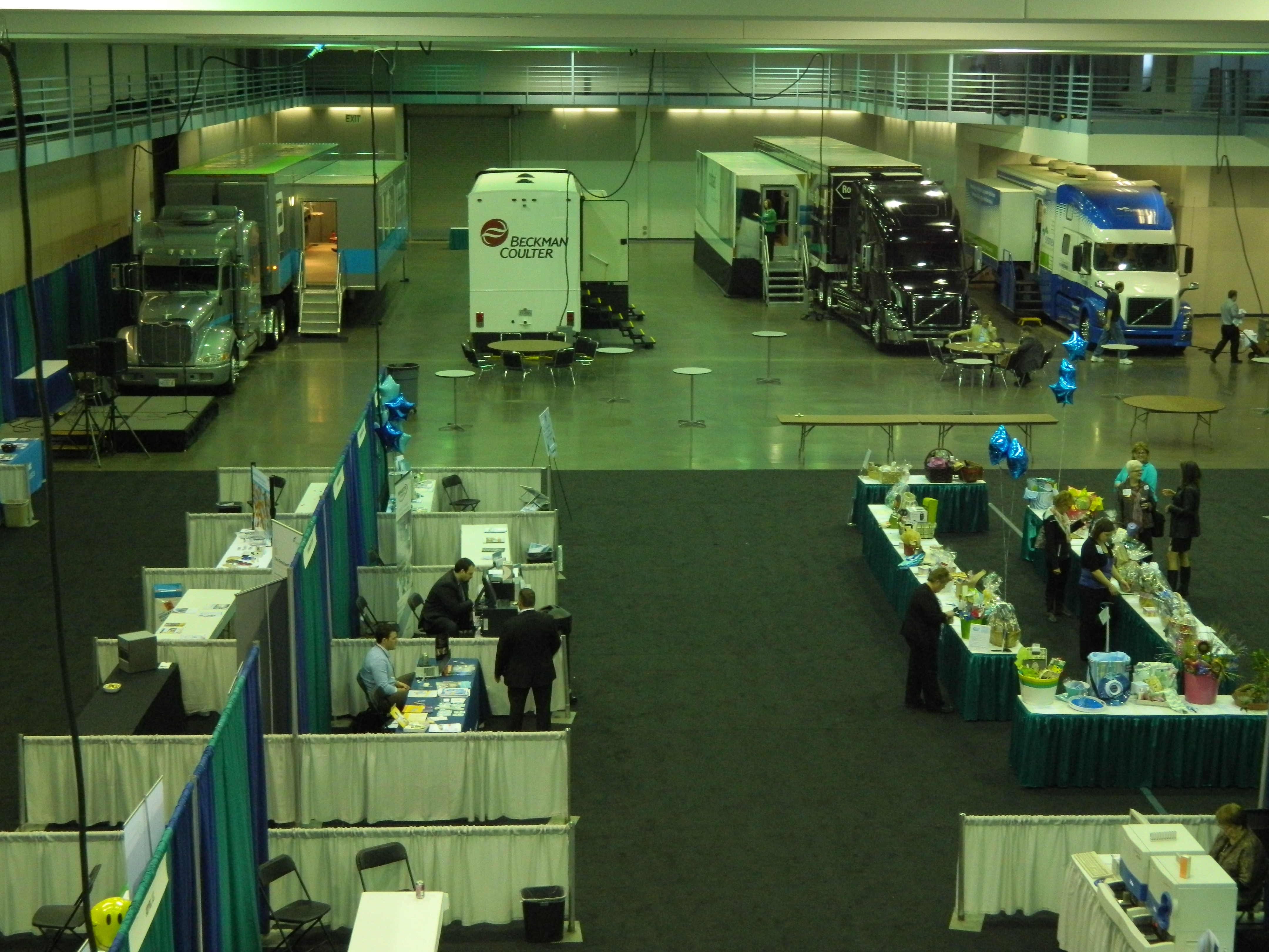Aerial view of people, booths, and exhibits in conventional hall for Collaborative Lab Conference