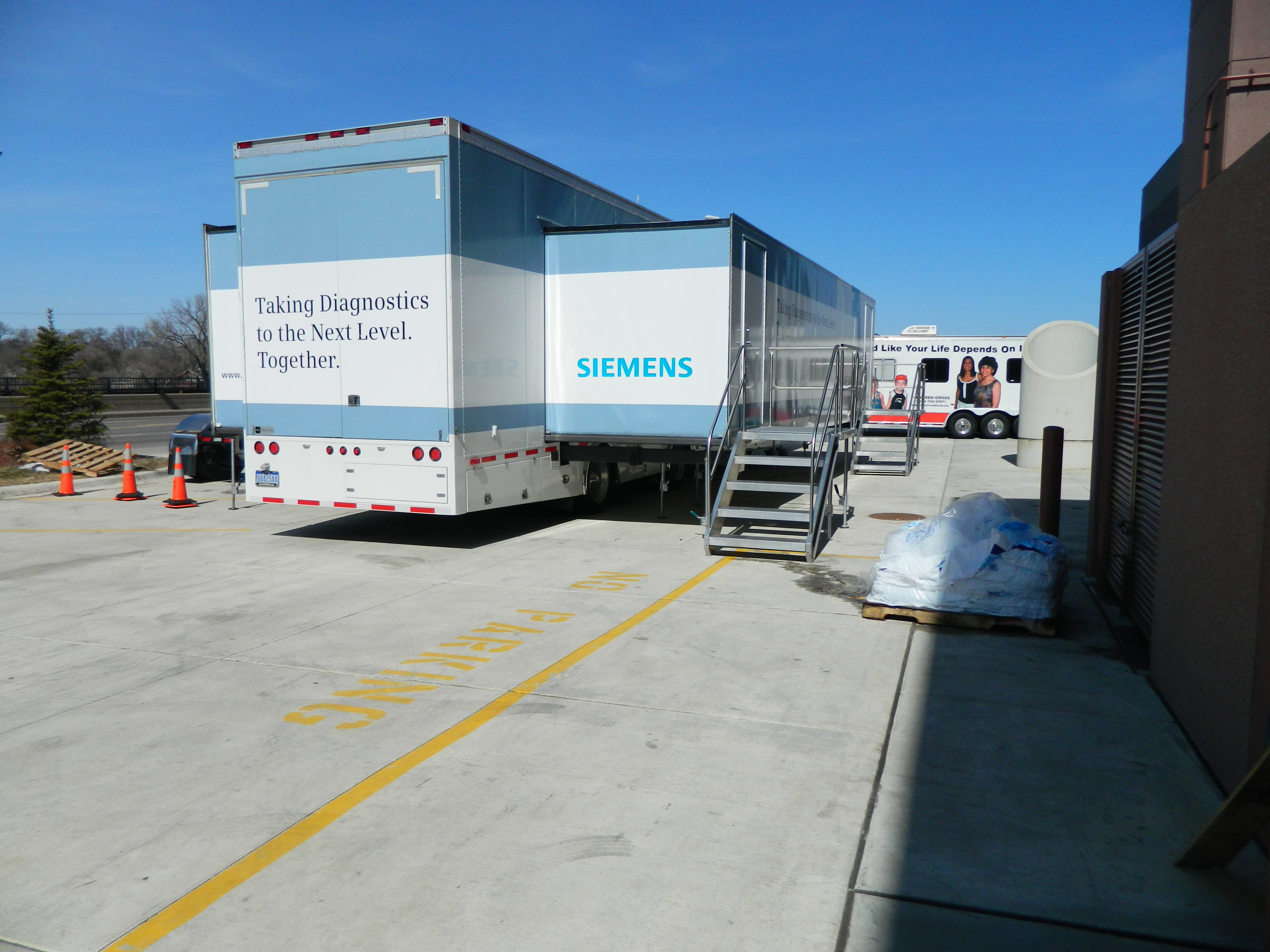 Large mobile command centers and vehicles parked outside