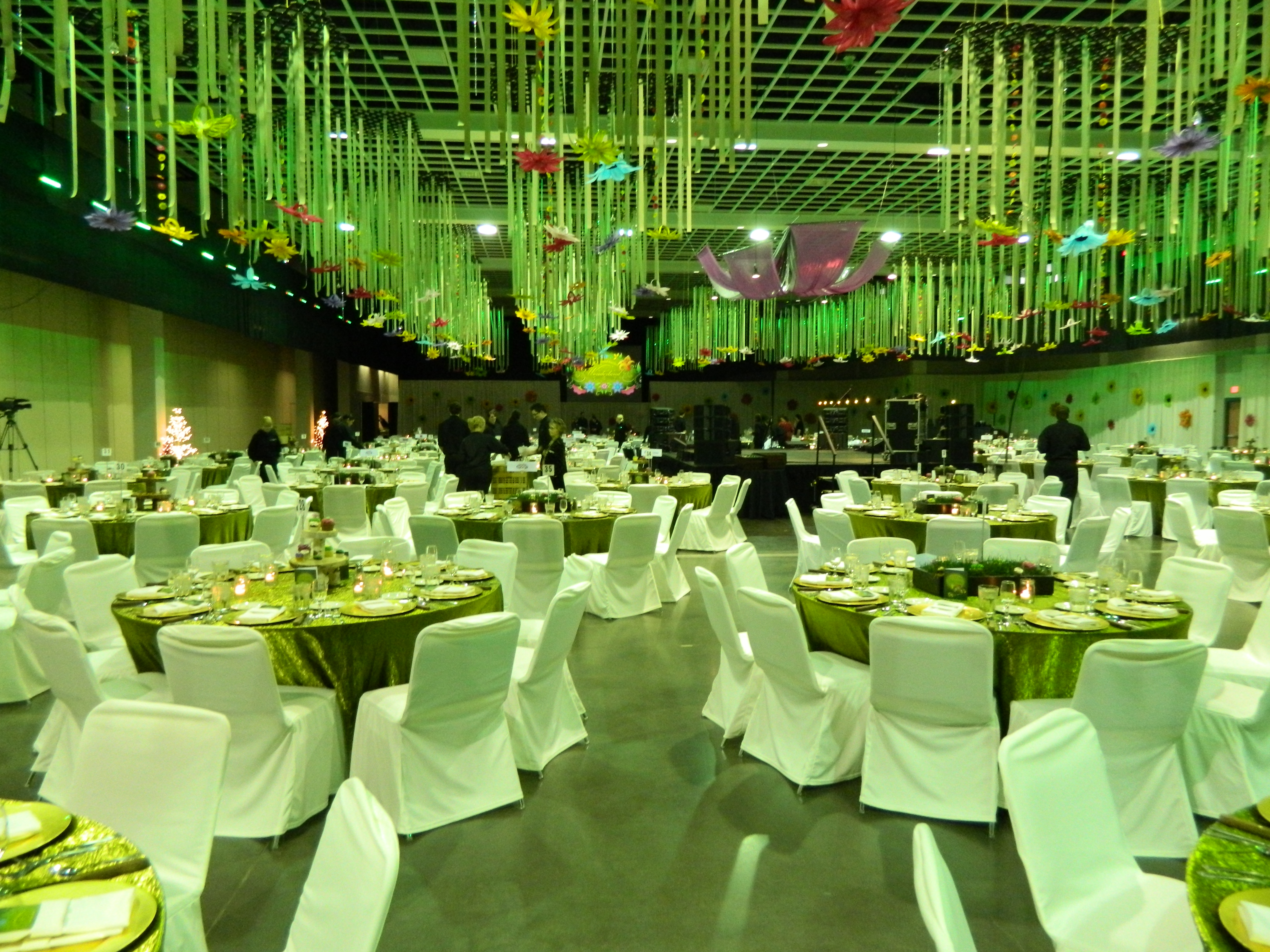 Hall decorated with hanging flower decorations and draped tables and chairs for Holly Ball 2012