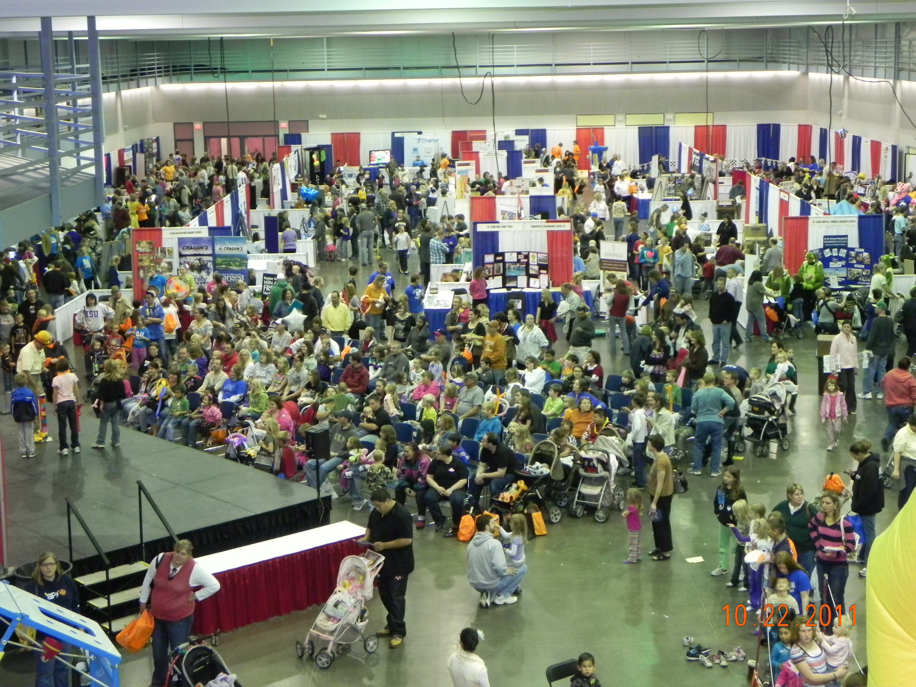 Aerial view of parents and kids gathered in convention hall for Kids and Parents Expo