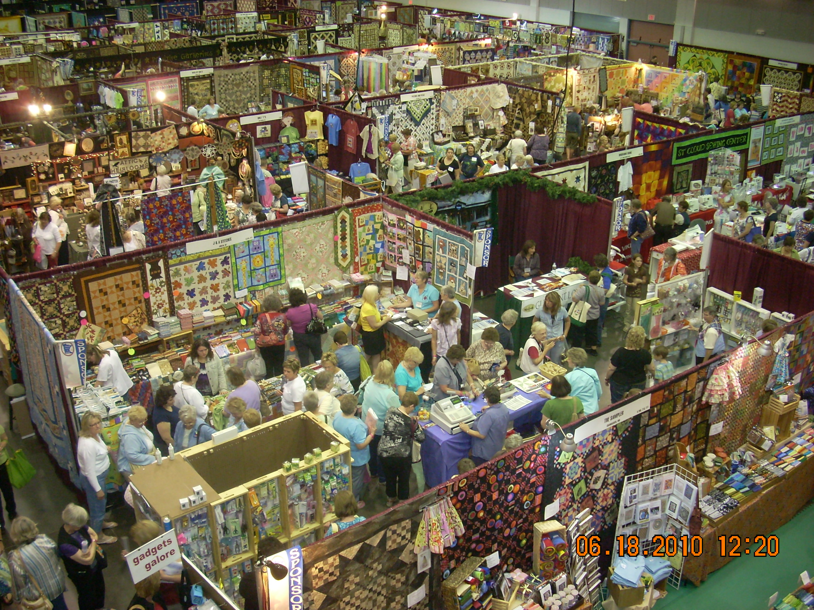 Aerial view of people and quilting exhibits in convention hall for Minnesota Quilter Convention 2012