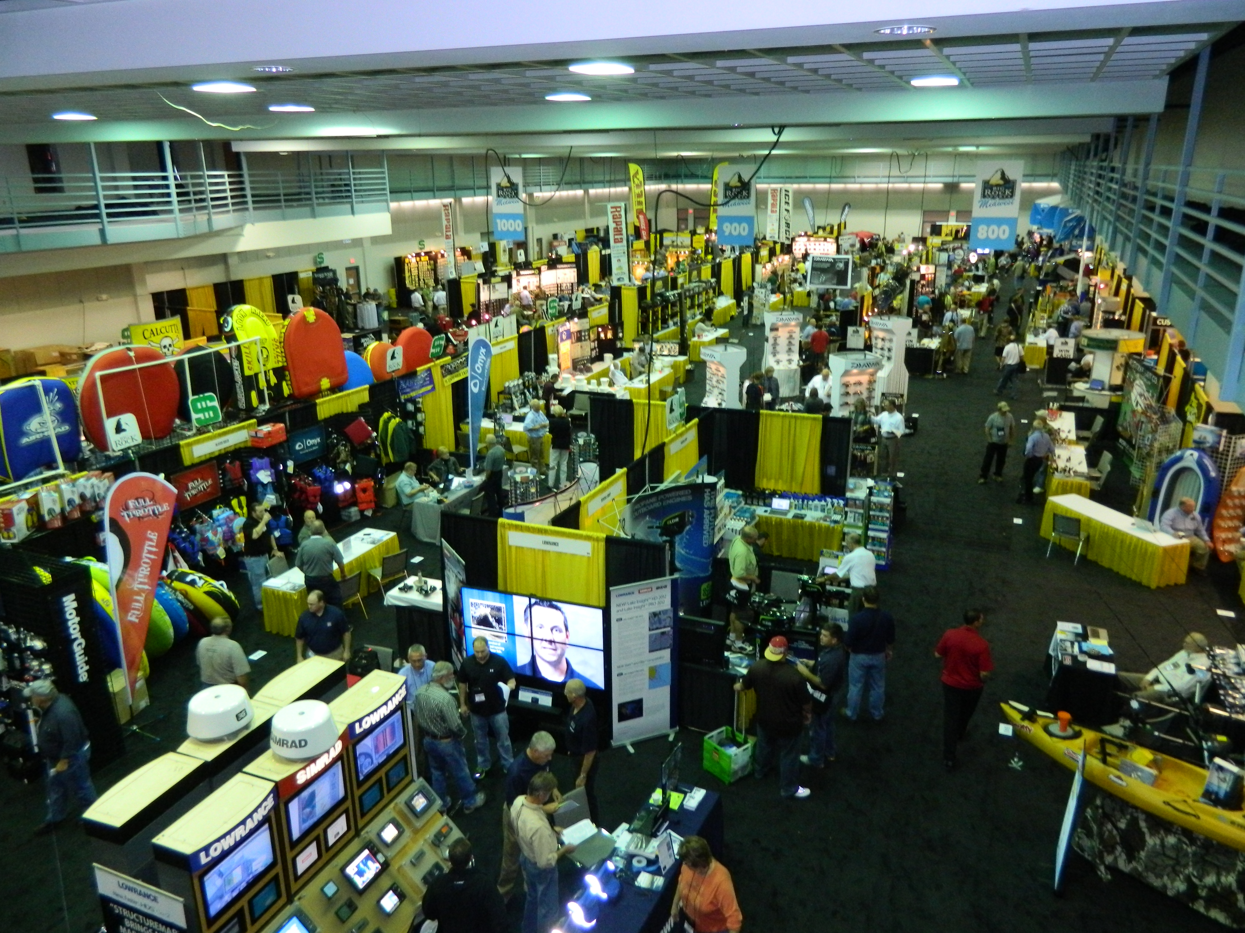 Aerial view of people and booths in convention hall for Big Rock Sports