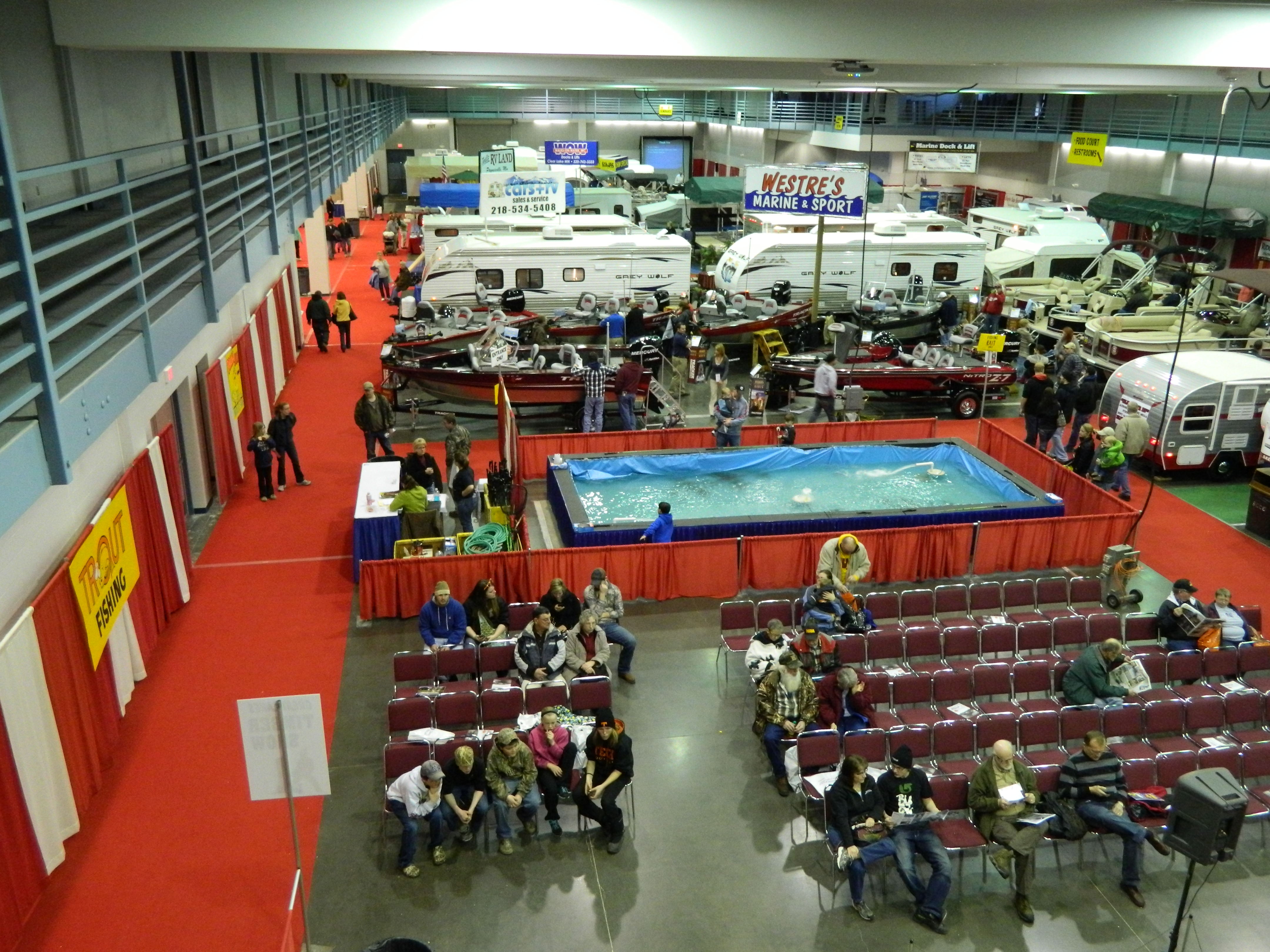 Aerial view of people, RVs, and exhibits in convention hall for Sportsmen's Show 2012